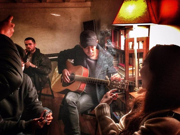 Jung Joon Young playing guitar in Paris 2016