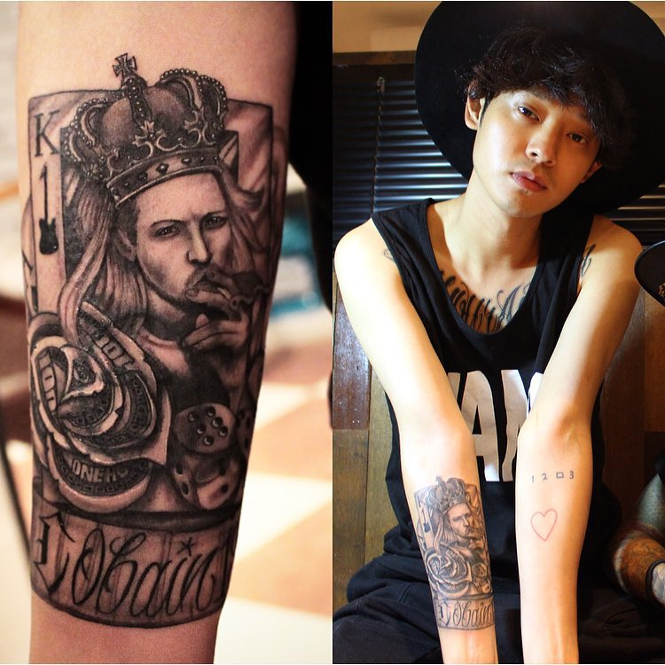 Jung Joon Young showing his King card Kurt Cobain cover-up tattoo