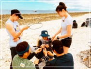 Jung Joon Young with fellow singers in Law of The Jungle in Timor Leste