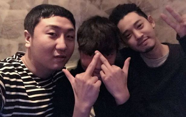 Jung Joon Young with friends in his restaurant in 2016